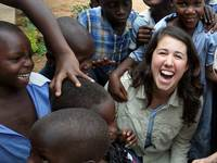 Meghan Gallagher playing with children in Uganda